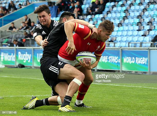 Shaun Stevenson and Caleb Makene of New Zealand fail to stop Joe Gage of Wales scoring a try during the World Rugby U20 Championship 5th Place Semi...