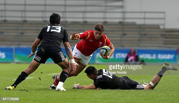 Shaun Stevenson and Patelesio Tomkinson of New Zealand tackle Joe Gage of Wales during the World Rugby U20 Championship 5th Place Semi Final between...