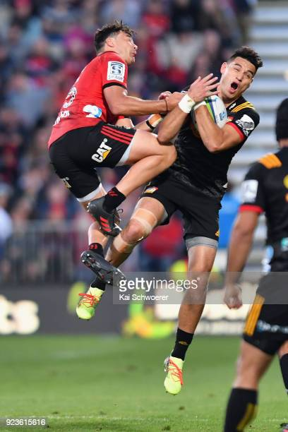 Shaun Stevenson of the Chiefs is tackled by David Havili of the Crusaders during the round two Super Rugby match between the Crusaders and the Chiefs...
