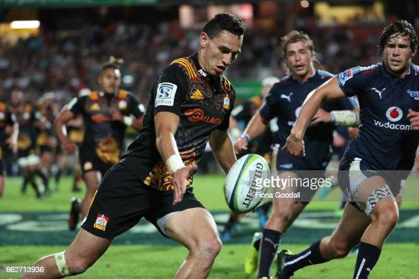 Shaun Stevenson of the Chiefs kicks ahead to score at try during the round six Super Rugby match between the Chiefs and the Bulls at Waikato Stadium...