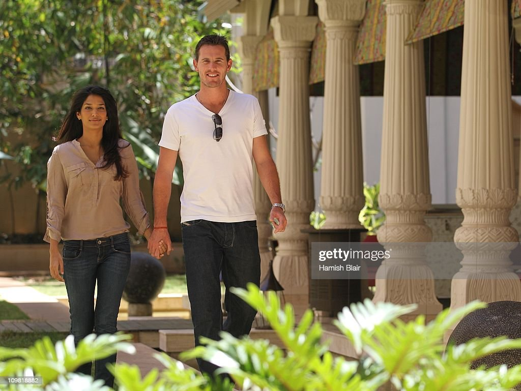 Shaun Tait and girlfriend Mashoom Singha pose for a photo in the gardens of the Royal Gardenia Hotel on March 7, 2011, in Bangalore, India.