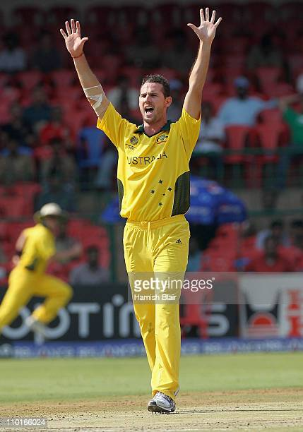 Shaun Tait of Australia appeals unsuccessfully against Zubin Surkari of Canada during the 2011 ICC World Cup Group A match between Australia and...