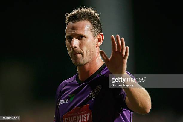 Shaun Tait of the Hobart Hurricanes acknowledges fans as he walks to his fielding position during the Big Bash League match between the Hobart...