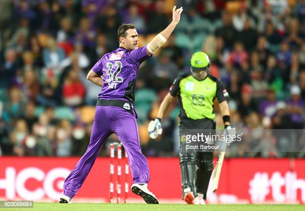 Shaun Tait of the Hurricanes appeals successfully to dismiss Shane Watson of the Thunder during the Big Bash League match between the Hobart...