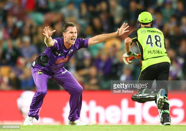 Shaun Tait of the Hurricanes appeals unsuccessfully as Mike Hussey of the Thunder runs between the wickets during the Big Bash League match between...
