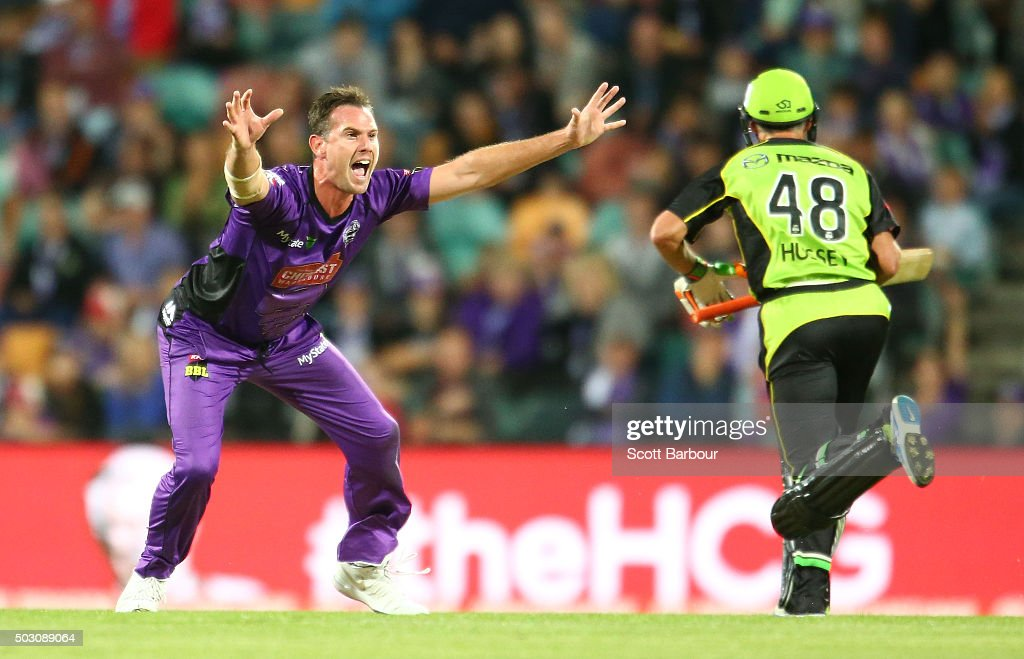 Shaun Tait of the Hurricanes appeals unsuccessfully as Mike Hussey of the Thunder runs between the wickets during the Big Bash League match between the Hobart Hurricanes and the Sydney Thunder at Blundstone Arena on January 1, 2016 in Hobart, Australia.