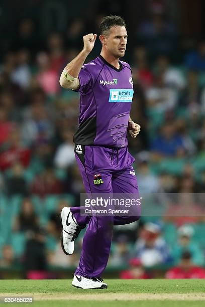 Shaun Tait of the Hurricanes celebrates dismissing Sean Abbott of the Sixers during the Big Bash League match between the Sydney Sixers and Hobart...