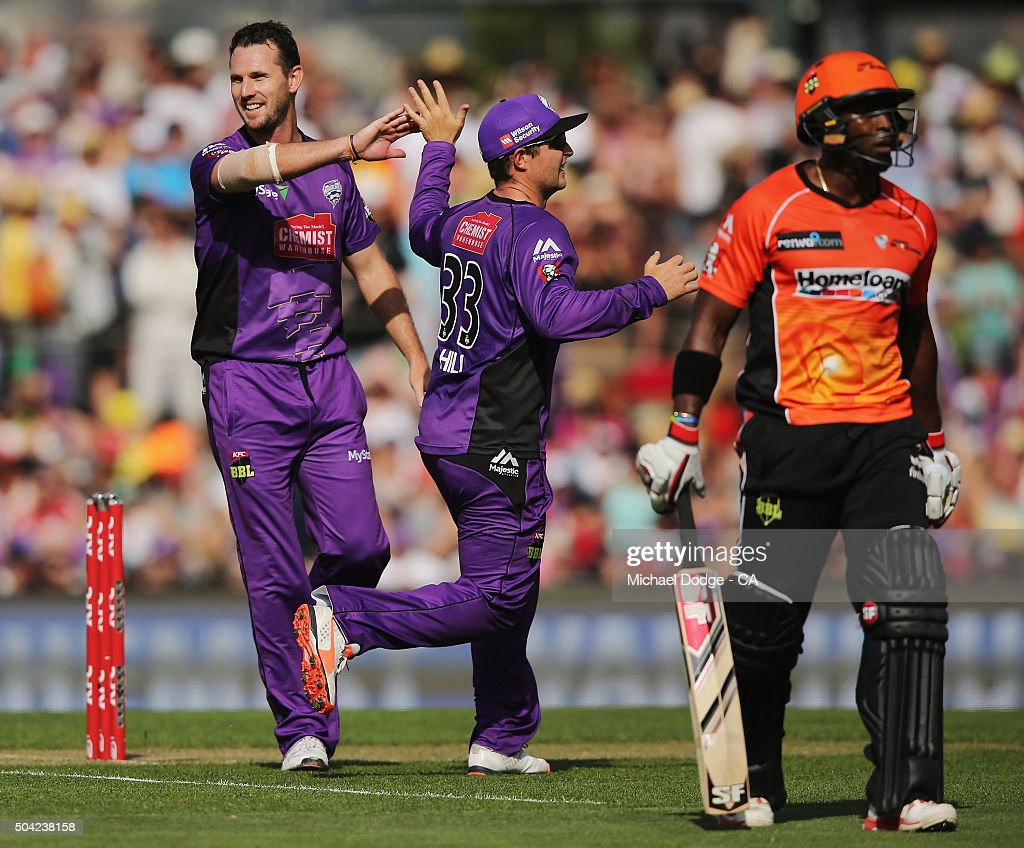 Shaun Tait of the Hurricanes (L) celebrates his wicket of Michael Carberry of the Scorchers with Michael Hill during the Big Bash League match between the Hobart Hurricanes and the Perth Scorchers at Blundstone Arena on January 10, 2016 in Hobart, Australia.