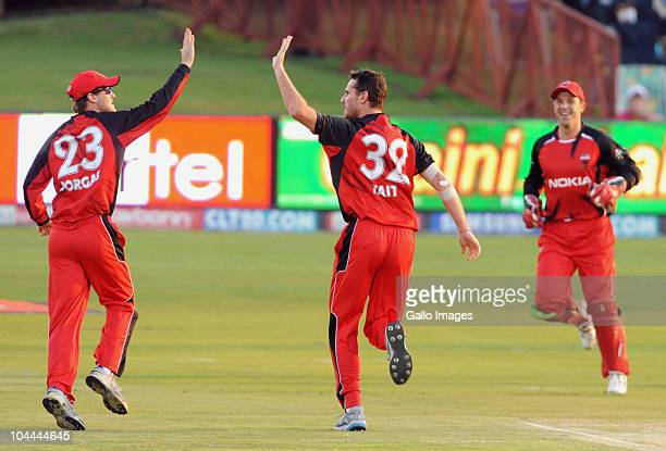 Shaun Tait of the Redbacks celebrates with teammates after taking the wicket of Ashwell Prince of the Warriors during the Airtel Champions League...