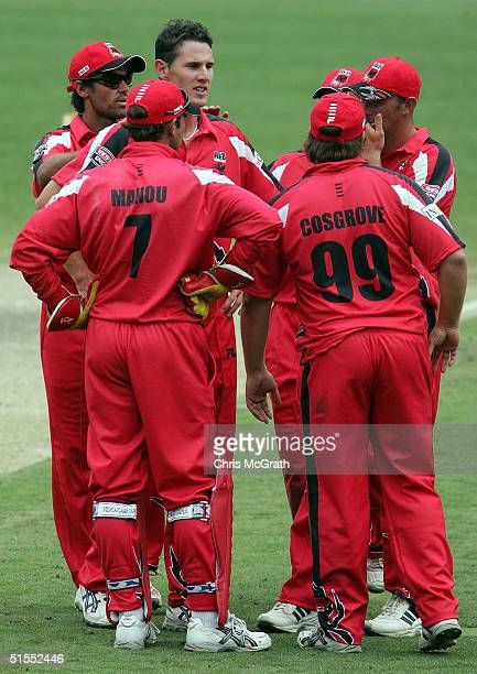 Shaun Tait of the Redbacks is congratulated by team mates after taking the wicket of Wade Seccombe of the Bulls during the ING Cup match between the...