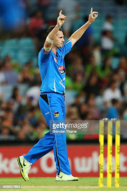 Shaun Tait of the Strikers celebrates at the end of play after victory over the Thunder during the Big Bash League match between Sydney Thunder and...