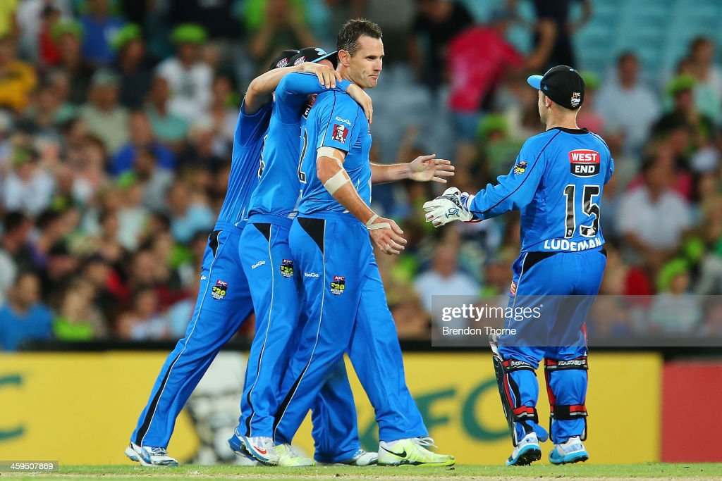 Shaun Tait of the Strikers celebrates with team mates after claiming the wicket of Mike Hussey of the Thunder during the Big Bash League match between Sydney Thunder and the Adelaide Strikers at ANZ Stadium on December 27, 2013 in Sydney, Australia.