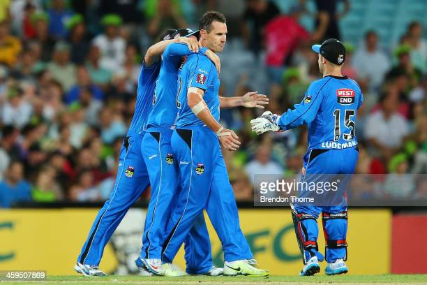 Shaun Tait of the Strikers celebrates with team mates after claiming the wicket of Mike Hussey of the Thunder during the Big Bash League match...