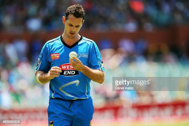 Shaun Tait of the Strikers prepares to bowl during the Big Bash League match between the Adelaide Strikers and Brisbane Heat at Adelaide Oval on...
