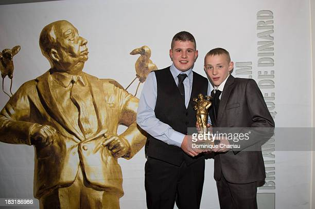 Shaun Thomas and Conner Chapman pose with the golden Hitchcock after the Dinard British film festival closing ceremony on October 5 2013 in Dinard...