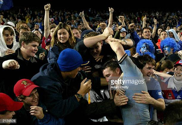 Shaun Timmins of the Blues celebrates the teams victory with the crowd after Game 2 of the NRL State of Origin Series between the New South Wales...