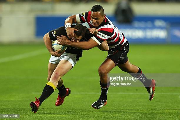 Shaun Treeby of Wellington is tackled by Toni Pulu of Counties Manukau during the ITM Cup semi final match between Wellington and Counties Manukau at...