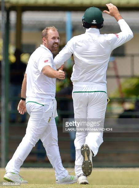 Shaun von Berg of South Africa celebrates with his teammate Aiden Markram after he dismissed Danushka Gunathilaka of Sri Lanka Board XI during the...