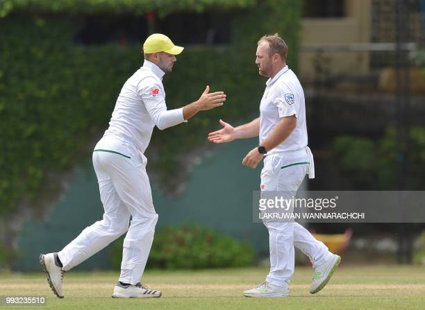 Shaun von Berg of South Africa celebrates with his teammate Aiden Markram after dismissing Dhananjaya de Silva of Sri Lanka Board XI during the...