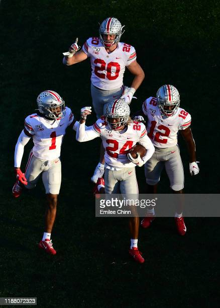 Shaun Wade, Jeff Okudah, Sevyn Banks and Pete Werner of the Ohio State Buckeyes celebrate an interception by Wade in the first quarter of their game...