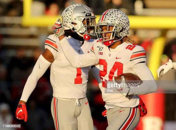 Shaun Wade of the Ohio State Buckeyes celebrates his interception with teammate Jeff Okudah in the first quarter against the Rutgers Scarlet Knights...