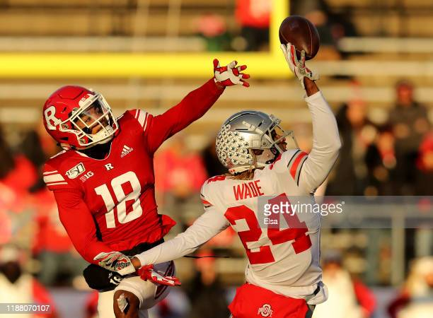 Shaun Wade of the Ohio State Buckeyes intercepts a pass intended for Bo Melton of the Rutgers Scarlet Knights in the first quarter at SHI Stadium on...