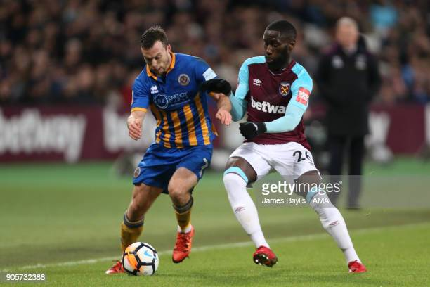 Shaun Whaley of Shrewsbury Town competes with Arthur Masuaku of West Ham United during the Emirates FA Cup Third Round Repaly match between West Ham...