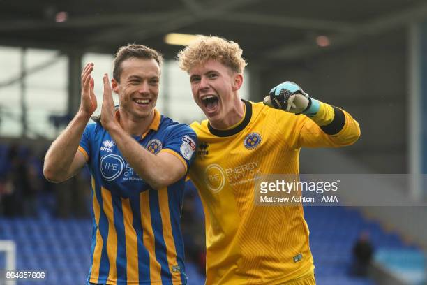 Shaun Whalley and goalkeeper Dean Henderson of Shrewsbury Town celebrate victory at the end of the game during the Sky Bet League One match between...