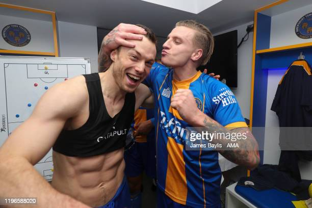 Shaun Whalley and Jason Cummings of Shrewsbury Town celebrate the result in the dressing room after the FA Cup Fourth Round match between Shrewsbury...
