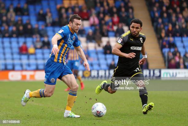 Shaun Whalley of Shrewsbury Town and Andy Barcham of AFC Wimbledon during the Sky Bet League One match between Shrewsbury Town and AFC Wimbledon at...