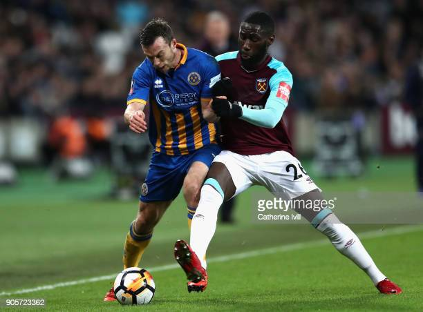 Shaun Whalley of Shrewsbury Town and Arthur Masuaku of West Ham United battle for the ball during The Emirates FA Cup Third Round Replay match...