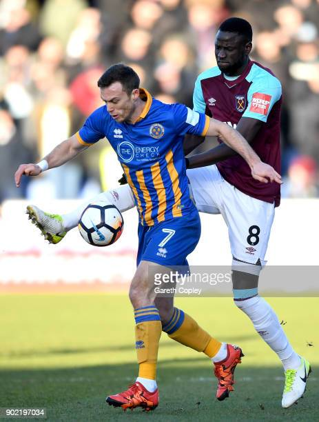 Shaun Whalley of Shrewsbury Town and Cheikhou Kouyate of West Ham United battle for the ball during The Emirates FA Cup Third Round match between...