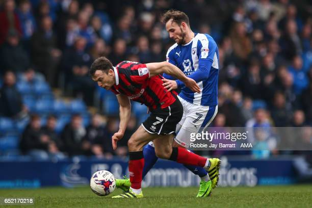 Shaun Whalley of Shrewsbury Town and Dan Gardner of Chesterfield during the Sky Bet League One match between Chesterfield and Shrewsbury Town at...