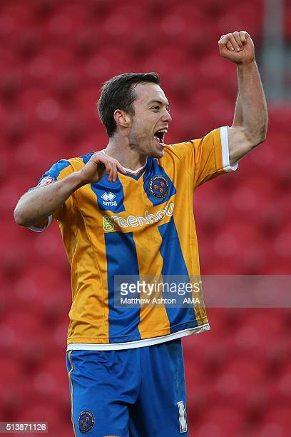 Shaun Whalley of Shrewsbury Town celebrates victory at the end of the Sky Bet League One match between Doncaster Rovers and Shrewsbury Town at...