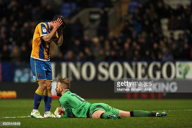 Shaun Whalley of Shrewsbury Town looks at Ben Alnwick of Bolton Wanderers as he saves at his feet during the Sky Bet League One match between Bolton...