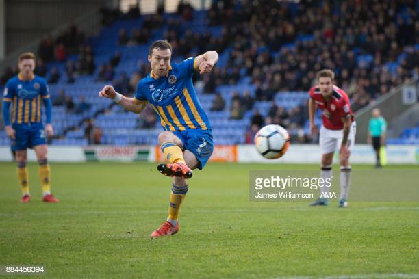 Shaun Whalley of Shrewsbury Town scores a goal from the penalty spot to make it 20 during the Emirates FA Cup march between Shrewsbury Town and...
