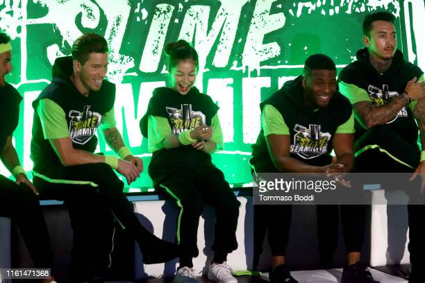 Shaun White Alysa Liu Kel Mitchell and Nyjah Huston participate in a challenge onstage during Nickelodeon Kids' Choice Sports 2019 at Barker Hangar...