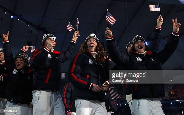 Shaun White and the United States team enter into the stadium during the Opening Ceremony of the 2010 Vancouver Winter Olympics at BC Place on...
