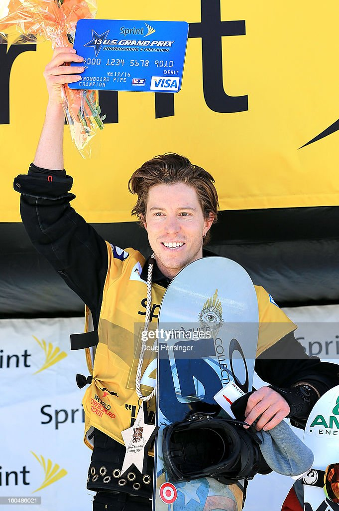 Shaun White celebrates as he takes the podium after winning the FIS Snowboard Halfpipe World Cup at the Sprint U.S. Grand Prix at Park City Mountain on February 1, 2013 in Park City, Utah.