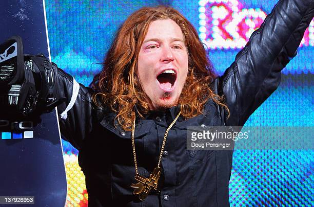 Shaun White celebrates as he takes the podium for the goal medal in the men's snowboard superpipe final during Winter X Games 2012 at Buttermilk...