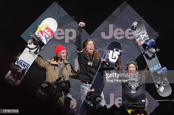 Shaun White celebrates as he takes the podium for the goal medal in the men's snowboard superpipe final along with Iouri Podladtchikov of Switzerland...