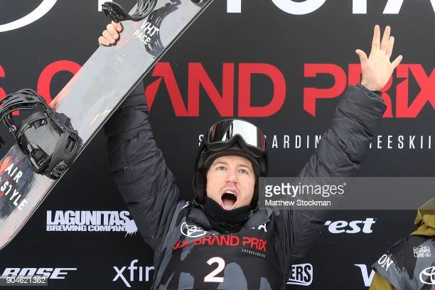 Shaun White celebrates on the medals podium after winning the Men's Snowboard Halfpipe final during the Toyota US Grand Prix on January 13 2018 in...