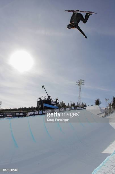 Shaun White does a backside air above the pipe as he warms up before the men's snowboard superpipe elimination during Winter X Games 2012 at...
