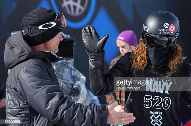 Shaun White hi fives his coach Bud Keene during practice for the men's snowboard superpipe elimination during Winter X Games 2012 at Buttermilk...