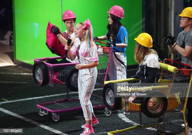 Shaun White JoJo Siwa Maia Shibutani Chloe Kim and Alex Shibutani participate in a challange onstage during the Nickelodeon Kids' Choice Sports 2018...