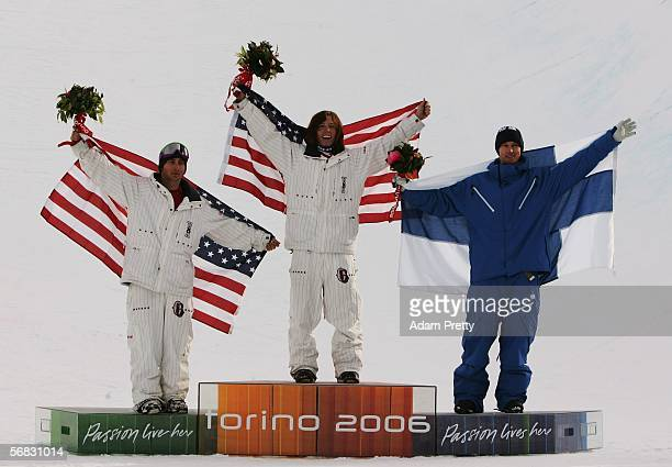 Shaun White of the United States celebrates after winning the Gold Medal with teammate Daniel Kass and Markku Koski of Finland in the Mens Snowboard...