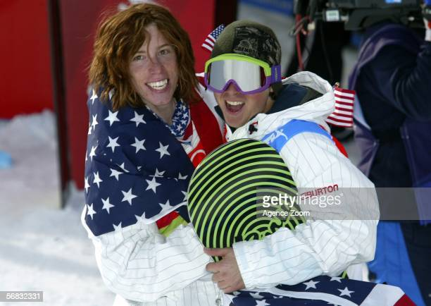 Shaun White of the United States celebrates after winning the gold medal with teammate Daniel Kass in the Mens Snowboard Half Pipe Final on Day 2 of...