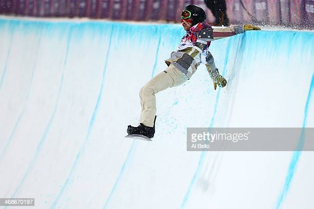 Shaun White of the United States crashes out in the Snowboard Men's Halfpipe Finals on day four of the Sochi 2014 Winter Olympics at Rosa Khutor...