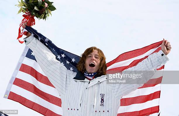 Shaun White of the USA celebrates winning the Gold medal in the Men's Halfpipe finals during Day 2 of the Turin 2006 Winter Olympic Games on February...