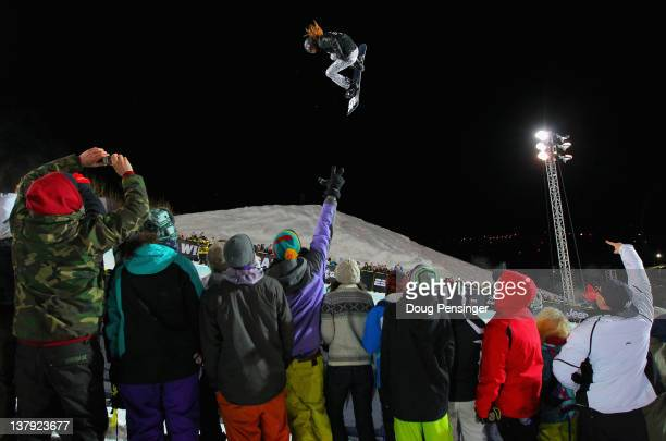 Shaun White soars above the spectators en route to winning the goal medal in the men's snowboard superpipe final during Winter X Games 2012 at...